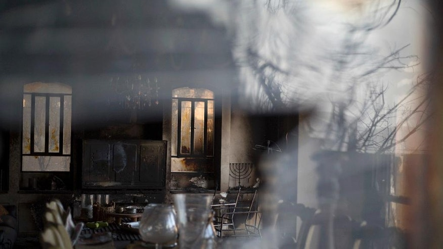A home damaged from fire is seen in Zikhron Ya'akov, Israel, Wednesday, Nov. 23, 2016.  Due to dry conditions, wildfires broke out for the second day in Israel. In Zikhron Ya'akov around ten homes were burned and about fifteen people sustained light injuries from smoke inhalation. (AP Photo/Ariel Schalit)