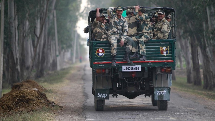 Indian Border Security Force soldiers travel on a truck to be deputed for night patrol duty along the India-Pakistan international border in Ranbir Singh Pura, about 25 kilometers from Jammu, India, Wednesday, Nov. 23, 2016. Artillery fire and shelling from India targeted several villages and struck a passenger bus near the dividing line in the disputed region of Kashmir on Wednesday, killing more than 10 civilians, the Pakistani military and officials said. An Indian army spokesman, Col. Nitin Joshi, said India was responding to Pakistan's violation. Both sides accuse the other of initiating the firing along the Line of Control, which separates the Pakistan- and India-controlled parts of Kashmir. (AP Photo/Channi Anand)