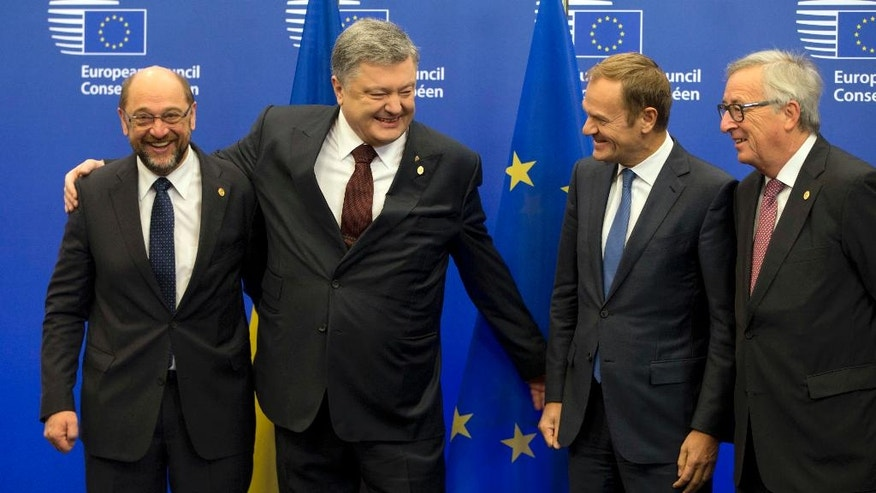 European Parliament President Martin Schultz, left, welcomes Ukrainian President Petro Poroshenko, second left, during an EU-Ukraine summit at the European Council building in Brussels on Thursday, Nov. 24, 2016. At right is European Commission President Jean-Claude Juncker and second right is European Council President Donald Tusk. (AP Photo/Virginia Mayo)