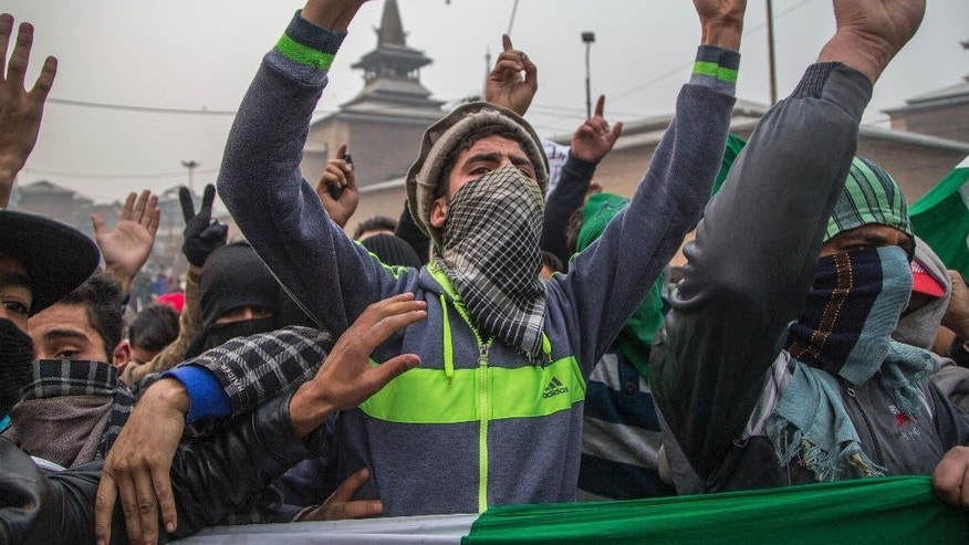 Kashmiri Muslims shout freedom slogans outside Jamia Masjid in Srinagar, Indian controlled Kashmir, Friday, Nov. 25, 2016. Government forces took extra security measures as authorities allowed Friday prayers for the first time in more than four months at the main mosque, Jamia Masjid, in downtown Srinagar city. (AP Photo/Dar Yasin)