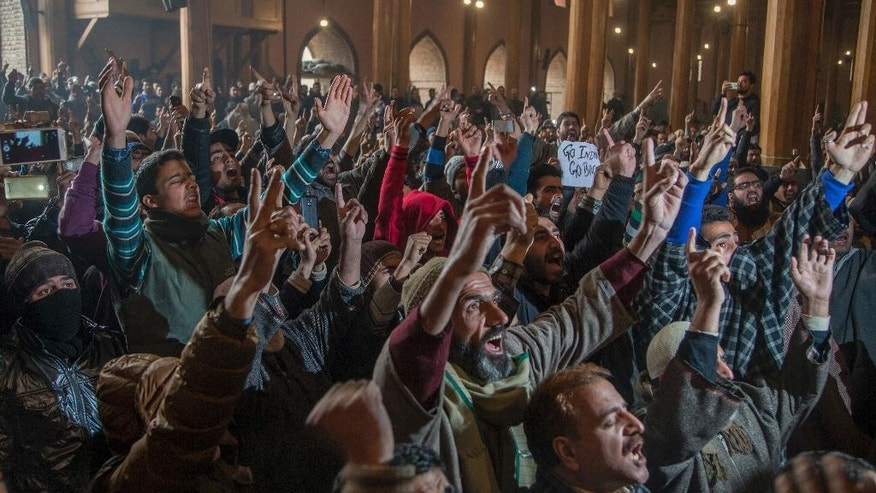 Kashmiri Muslims shout freedom slogans inside Jamia Masjid in Srinagar, Indian controlled Kashmir, Friday, Nov. 25, 2016. Government forces took extra security measures as authorities allowed Friday prayers for the first time in more than four months at the main mosque, Jamia Masjid, in downtown Srinagar city. (AP Photo/Dar Yasin)