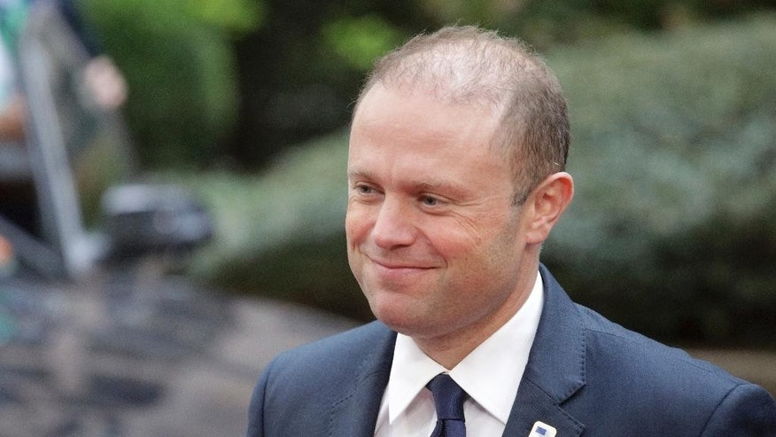 FILE - In this Thursday, Oct. 20, 2016 file photo, Malta's Prime Minister Joseph Muscat arrives for the EU summit in Brussels. Joseph Muscat, whose country is about to assume presidency of the European Union for six months from Jan. 1, 2017, says Britain's exit from the bloc will see both sides lose out. (AP Photo/Olivier Matthys, File)