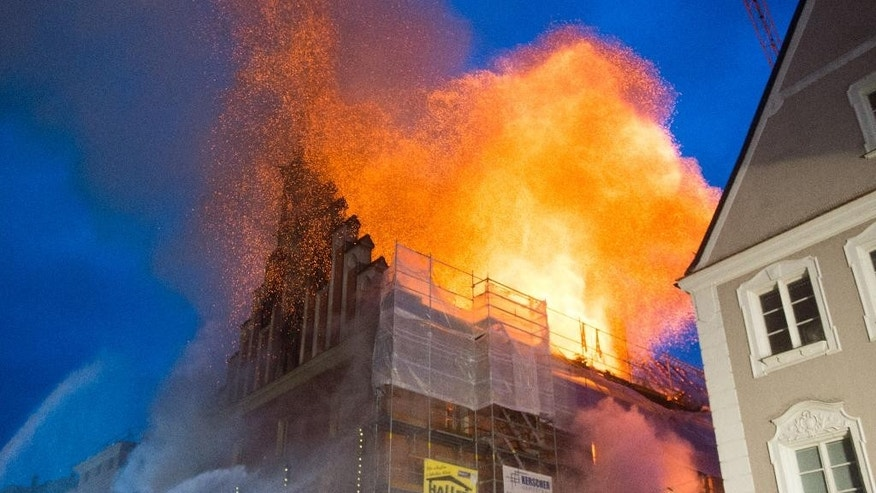 The town hall of Straubing is on fire in Straubing, southern Germany, Friday, Nov.25, 2016. (Armin Weigel/dpa via AP)