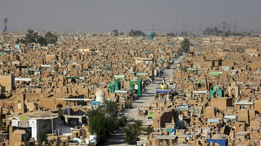 """This photo shows general view of the Wadi al-Salam, or """"Valley of Peace"""" cemetery which contains the graves of militiamen killed from fighting with Islamic State group militants, in Najaf, 100 miles (160 kilometers) south of Baghdad, Iraq on Friday, Nov. 25, 2016. For decades, the rapid expansion of the cemetery in Iraq's holy Shiite city of Najaf has testified to the scale of violence of Iraq's contemporary history, from the ruinous 1980-88 war with Iran to the costly 1990-91 conflict over Kuwait and 13 years of uninterrupted bloodshed starting with the U.S. led invasion in 2003. With the government not publicizing casualties among the Shiite-dominated security forces now fighting in Mosul, burials in the sprawling cemetery offers a reliable indicator of battlefield losses on the government side.(AP Photo)"""