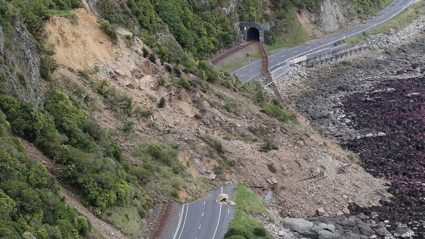 FILE - In this Nov. 14, 2016 file photo, a landslide blocks State Highway One and the main trunk railway line north of Kaikoura following an earthquake in New Zealand. In terms of human life, the magnitude 7.8 earthquake that hit New Zealand this month was relatively merciful: just two fatalities. But geologically, it moved roads and mountains and even displaced the sea, leaving a formidable mark from which tourism, farming and life in general may need years to recover. (Mark Mitchell/Pool Photo via AP, File)
