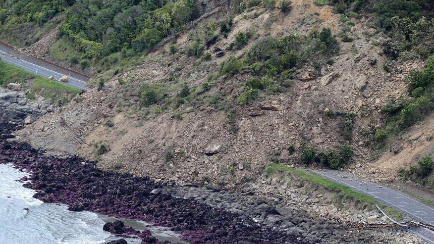 FILE - In this Monday, Nov. 14, 2016 file photo, landslide damage on State Highway One and the main trunk railway line are seen following an earthquake, north of Kaikoura, New Zealand. In terms of human life, the magnitude 7.8 earthquake that hit New Zealand this month was relatively merciful: just two fatalities. But geologically, it moved roads and mountains and even displaced the sea, leaving a formidable mark from which tourism, farming and life in general may need years to recover. (Mark Mitchell/New Zealand Herald, Pool via AP,File)