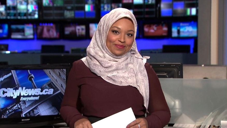 This image made from a video provided by CityNews shows Ginella Massa, a Toronto TV reporter who is believed to be Canada's first anchor to don a Muslim head scarf at one of the city's major news broadcasters. Massa, 29, said Friday, Nov. 25, 2016, that she became Canada's first hijab-wearing television news reporter in 2015 while reporting for CTV News in Kitchener, Ontario, a city west of Toronto. She moved back to Toronto, where she grew up, earlier this year to take a reporting job at CityNews. (CityNews via AP)