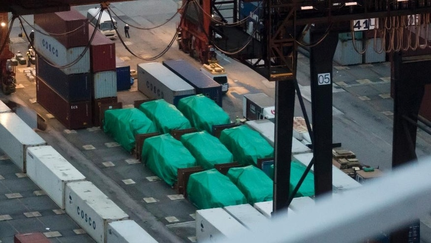 This Thursday, Nov. 24, 2016 photo shows nine eight-wheeled Singapore-made Terrex infantry carrier vehicles seized at a container terminal in Hong Kong. Singapore's army is sending a team to Hong Kong to secure the nine of its armored personnel carriers that were seized by customs authorities while in transit through the southern Chinese territory, the Defense Ministry said Friday, Nov. 25. (AP Photo/Kin Cheung)