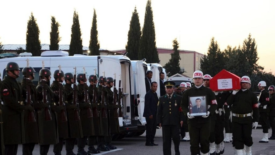 Soldiers carry the coffin of one of the Turkish soldiers killed, during a ceremony at the airport in Gaziantep, Turkey, Thursday, Nov. 24, 2016. Three Turkish soldiers were killed and 10 were wounded in northern Syria on Thursday in what the Turkish military said was a pre-dawn airstrike believed to have been carried out by Syrian government forces. Turkish authorities have banned distribution of images relating to the Syria attack within Turkey. (AP Photo)
