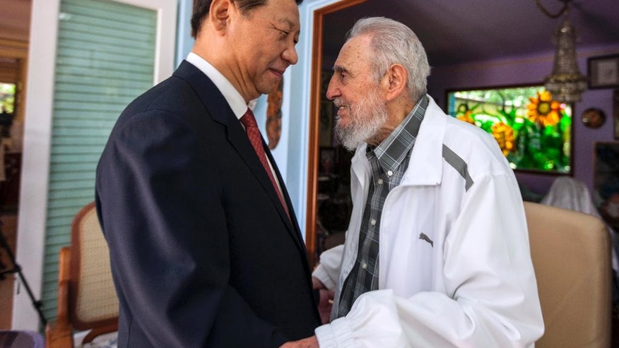 FILE - In this July 22, 2014 file photo, Cuba's former President Fidel Castro, right, greets China's President Xi Jinping in Havana, Cuba. Castro, who led a rebel army to victory in Cuba, embraced Soviet-style communism and defied the power of 10 U.S. presidents during his half century rule, died at age 90 on Friday, Nov 25, 2016. Viewed from the world's largest communist country, Castro's death is a reminder of how the communist axis has changed beyond recognition since the ideologically charged era when the bearded revolutionary cut a dashing figure on the world stage alongside leaders like Mao Zedong. (AP Photo/Alex Castro, File)