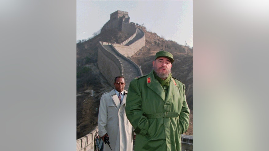 FILE - In this Friday, Dec. 1, 1995 file photo, Cuban President Fidel Castro stands on the Great Wall of China, 70 kilometers (44 miles) north of Beijing. Castro, who led a rebel army to victory in Cuba, embraced Soviet-style communism and defied the power of 10 U.S. presidents during his half century rule, died at age 90 on Friday, Nov 25, 2016. Viewed from the world's largest communist country, Castro's death is a reminder of how the communist axis has changed beyond recognition since the ideologically charged era when the bearded revolutionary cut a dashing figure on the world stage alongside leaders like Mao Zedong. (AP Photo/Greg Baker, File)