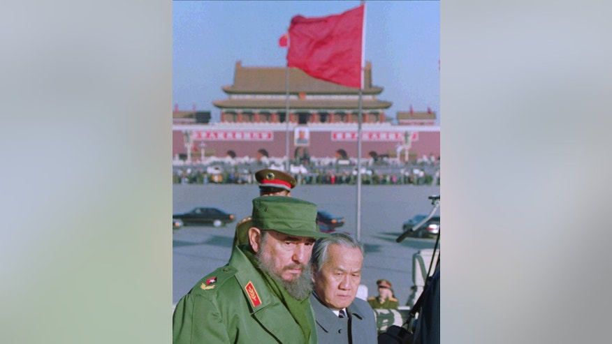 FILE - In this Dec. 2, 1995 file photo, Cuban President Fidel Castro tours Beijing's Tiananmen Square after laying a wreath at the Monument to the People's Heroes, which commemorates fallen communist revolutionaries. Castro, who led a rebel army to victory in Cuba, embraced Soviet-style communism and defied the power of 10 U.S. presidents during his half century rule, died at age 90 on Friday, Nov 25, 2016. Viewed from the world's largest communist country, Castro's death is a reminder of how the communist axis has changed beyond recognition since the ideologically charged era when the bearded revolutionary cut a dashing figure on the world stage alongside leaders like Mao Zedong. (AP Photo/Greg Baker, File)
