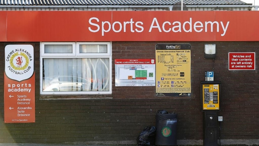 A sign for the sports academy of the English soccer team Crewe Alexandra at the Alexandra Stadium, in Crewe northern England Friday Nov. 25, 2016. Former soccer players who were subjected to years of sexual abuse by youth team coaches entrusted with their care are breaking cover to expose the English game's dark secrets. The abuses were first uncovered two decades ago with the conviction in the United States of English coach Barry Bennell, who coached at the academy of northern English professional club Crewe Alexandra, which was renowned as a center for turning raw talent into the complete footballer. (Martin Rickett/PA via AP)
