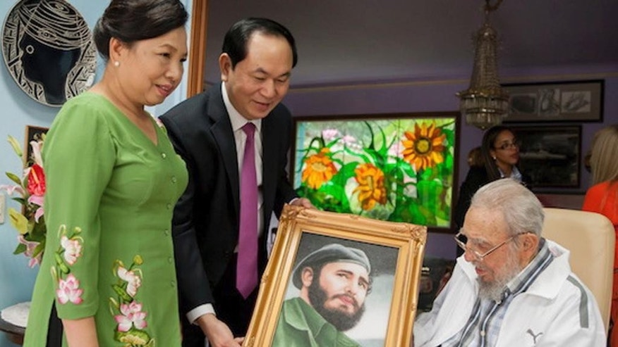In this Nov. 15, 2016 photo, Vietnam's President Tran Dai Quang, second from left, and his wife Nguyen Thi Hien gift a picture to Cuba's former leader Fidel Castro, in one of the last pictures taken of Castro before he died, in Havana, Cuba. President Raul Castro said on state television that his older brother died late Friday, Nov. 25, 2016. He was 90. (AP Photo/Alex Castro)