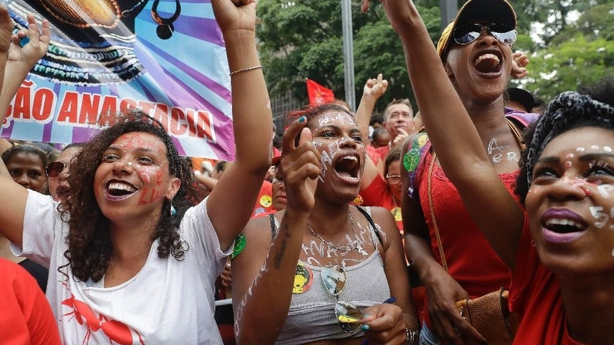 Demonstrators shout anti-government slogans as they demand the impeachment of Brazil's President Michel Temer in Sao Paulo, Brazil, Sunday, Nov. 27, 2016. Protesters expressed outrage at a host of Temer's policies, including the government's proposal to cap spending to rein in the deficit. (AP Photo/Andre Penner)