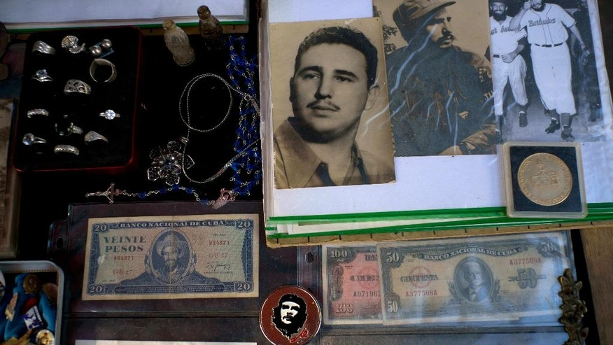Photos of Cuba's late leader Fidel Castro are displayed for sale at a street in Havana, Cuba, Sunday, Nov. 27, 2016. Cuba's government declared nine days of national mourning after Castro died Friday and this normally vibrant city has been notably subdued. (AP Photo/Ramon Espinosa)