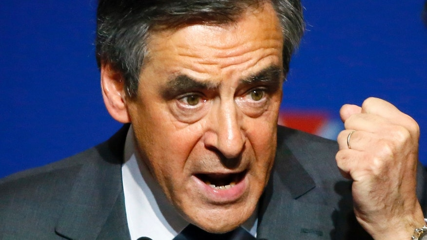 Francois Fillon, a candidate in Sunday's primary runoff to select a conservative candidate for the French presidential election, delivers his speech during a rally in Paris, Friday, Nov. 25, 2016.