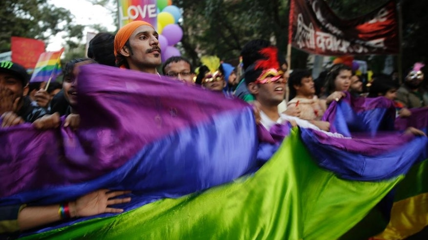 Indian gay rights activists and their supporters march during New Delhi's gay pride parade in New Delhi, India, Sunday, Nov. 27, 2016. Hundreds of gay rights activists marched in the parade, highlighting the continuing discrimination they face and demanding the repeal of an Indian law criminalizing homosexual acts. (AP Photo/Tsering Topgyal)