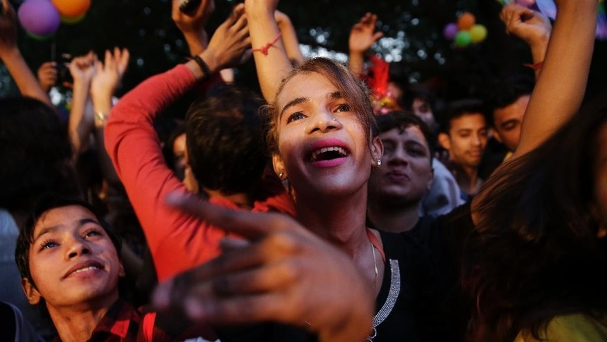 Participants dance as Indian gay rights activists and their supporters march during New Delhi's gay pride parade in New Delhi, India, Sunday, Nov. 27, 2016. Hundreds of gay rights activists marched in the parade, highlighting the continuing discrimination they face and demanding the repeal of an Indian law criminalizing homosexual acts.(AP Photo/Tsering Topgyal)