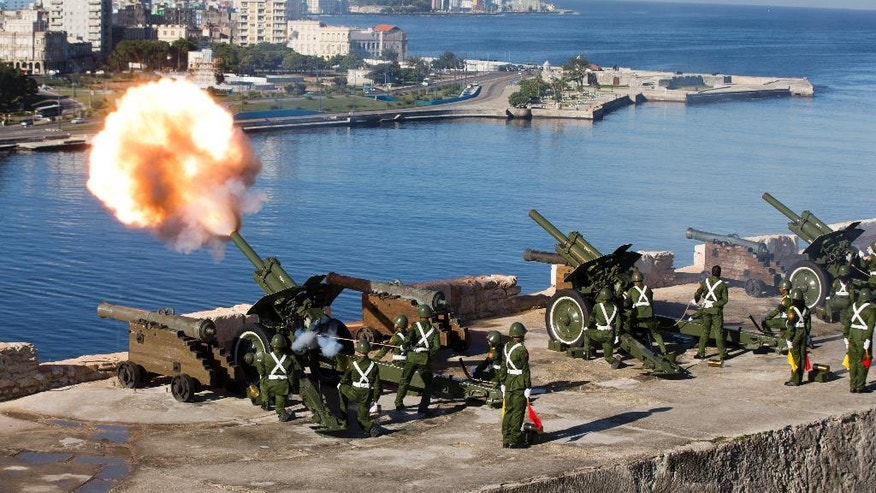 An honor guard fires off 21-gun salutes to mark the start of services paying tribute to the late Fidel Castro, in Havana, Cuba, Monday, Nov. 28, 2016. Uniformed troops fired artillery pieces at 9 a.m. from the Morro fort in Havana and from a fort in the eastern city of Santiago. Cuba's government has declared nine days of national mourning following Castro's death Friday night at age 90.  (AP Photo/Ricardo Mazalan)