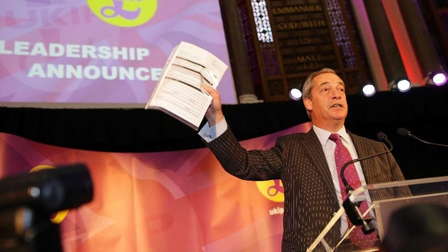 Nigel Farage, the acting leader of the right-wing U.K. Independence Party gestures before announcing the new leader of the party in London Monday Nov. 28, 2016. (AP Photo/Alastair Grant)