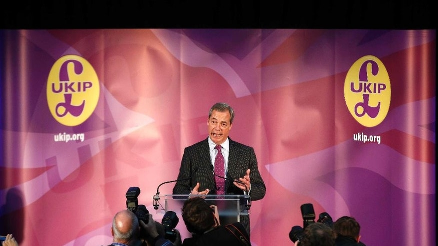 Nigel Farage, the acting leader of the right-wing U.K. Independence Party speaks before announcing the new leader of the party in London Monday Nov. 28, 2016. (AP Photo/Alastair Grant)