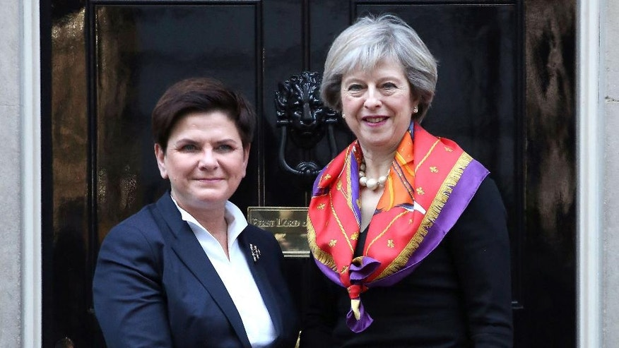 Britain's Prime Minister Theresa May, right, welcomes Poland's Prime Minister Beata Szydlo to 10 Downing Street, London, ahead of as part of the UK-Poland Inter-Governmental Consultations, Monday Nov. 28, 2016. (Philip Toscano/PA via AP)