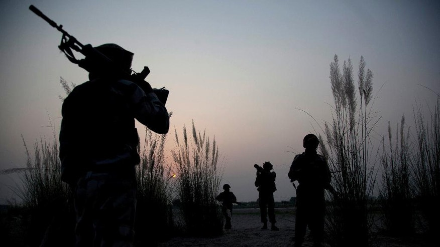 FILE - In this Oct. 4, 2016, file photo, Indian army soldiers patrol near the highly militarized Line of Control dividing Kashmir between India and Pakistan, in Pallanwal sector, about 75 kilometers (46.8 miles) from Jammu, India. An uneasy calm has fallen over the de facto border between the Indian and Pakistani-controlled portions of Kashmir after months of deadly firing and signs that the two countries were engaged in a brinkmanship not seen for decades. Though guns have gone silent for the past five days, analysts say the two nuclear-armed neighbors have displayed unprecedented aggression this year without pursuing any real lines of diplomacy. (AP Photo/Channi Anand, File)