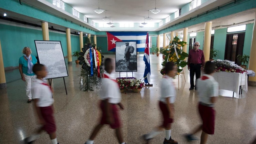 Students file past a memorial for the late Fidel Castro at a community center in the Ciudad Escolar Libertad neighborhood in Havana, Cuba, Monday, Nov. 28, 2016. Cubans on Monday began bidding farewell to Castro, the man who ruled the island for nearly half a century. Cuba's government has declared nine days of national mourning following Castro's death Friday night at age 90. (AP Photo/Ricardo Mazalan)