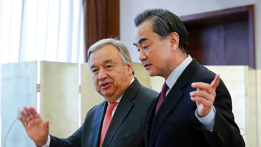 Antonio Guterres, left, incoming Secretary-General of the United Nations, chats with Chinese Foreign Minister Wang Yi after attending a joint press conference at the Ministry of Foreign Affairs in Beijing, Monday, Nov. 28, 2016. Guterres says he wants the U.N. to be more nimble and less bureaucratic and its peacekeepers to be better trained and respectful of human rights. (AP Photo/Andy Wong)