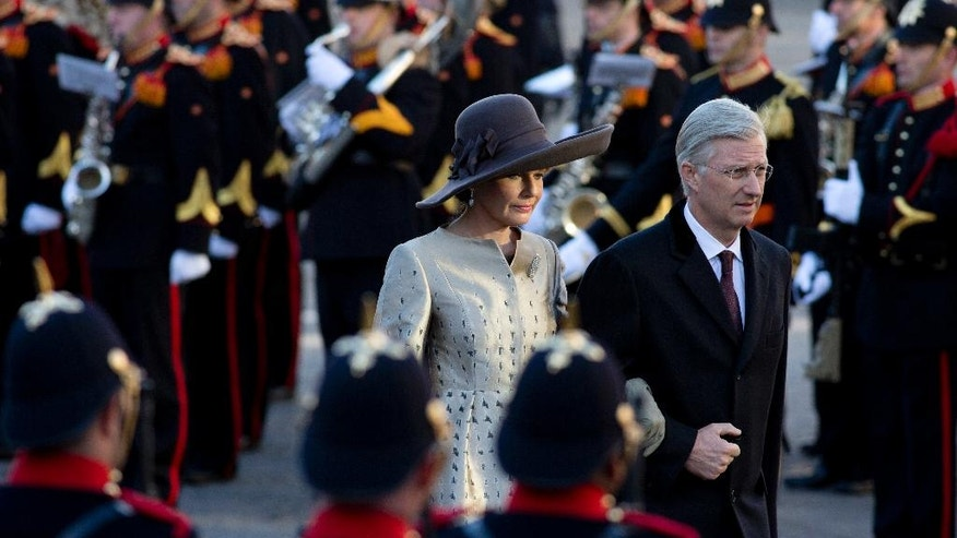 King Philippe and Queen Mathilde of Belgium walks towards the national monument on Dam square on the start of their three-day visit to The Netherlands, in Amsterdam, Monday, Nov. 28, 2016. (AP Photo/Peter Dejong)