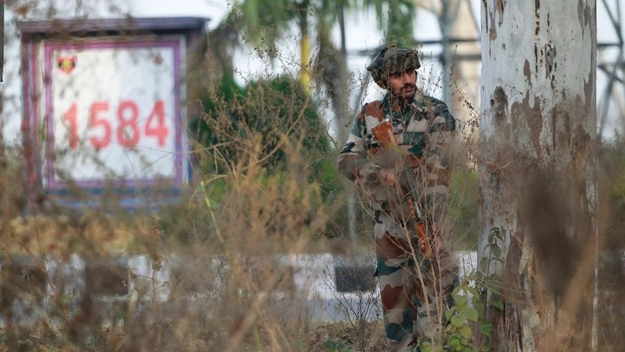 An Indian soldier takes position outside an army camp at Nagrota, in the outskirts of Jammu, India, Tuesday, Nov. 29, 2016. Police said that militants fired indiscriminately and tried to enter an army camp in Nagrota town, triggering a fierce gun battle. (AP Photo/Channi Anand)