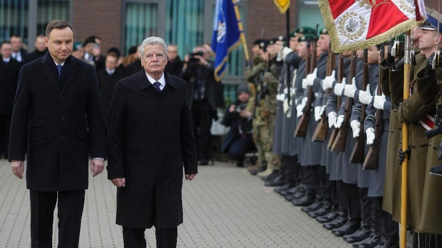 Polish President Andrzej Duda, left, and German President Joachim Gauck, 2. from left, review the honor guards during a  visit to the Headquarters of the Multinational Corps Northeast of the NATO, in Szczecin, Poland, Monday, Nov. 28, 2016. (AP Photo/Markus Schreiber)