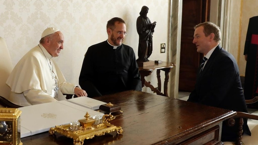 Pope Francis talks with Irish Prime Minister Enda Kenny, right, during a private audience in his private studio at the Vatican, Monday, Nov. 28, 2016. (AP Photo/Alessandra Tarantino, pool )