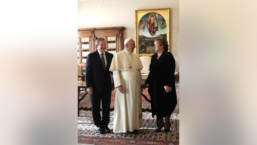 Pope Francis talks with Irish Prime Minister Enda Kenny, left, and his wife Fionnuala, during a private audience in his private studio at the Vatican, Monday, Nov. 28, 2016. (AP Photo/Alessandra Tarantino, pool )