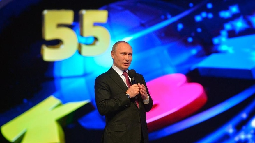 "Russian Prime Minister Vladimir Putin attends the anniversary game of international club comic and TV game show ""KVN"", in the Kremlin, celebrating the 55th anniversary of the airing in Moscow, Russia, Sunday, Nov. 27, 2016.  The KVN show is a humourous public talent competition for teams of mostly student competitors, which has been shown on national TV since 1961. (Alexei Druzhinin / Sputnik, Kremlin Pool Photo via AP)"