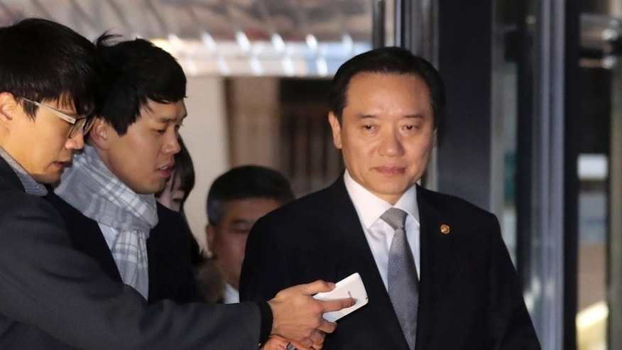 South Korean Justice Minister Kim Hyun-woong, right, is questioned by reporters at the Ministry of Justice in Gwacheon, South Korea, Monday, Nov. 28, 2016. South Korea's embattled president accepted the resignation of her justice minister on Monday, the latest in a series of personnel reshuffles she's made amid a political scandal that's threatening her leadership. (Choi Jae-gu/Yonhap via AP) KOREA OUT