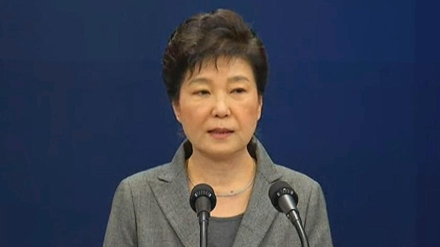 In this image made from video, South Korean President Park Geun-hye makes a live televised address in Seoul ,South Korea, Tuesday, Nov. 29, 2016.  The embattled president says she'll resign if parliament finds a plan for safe transfer of power. (Yonhap via AP)