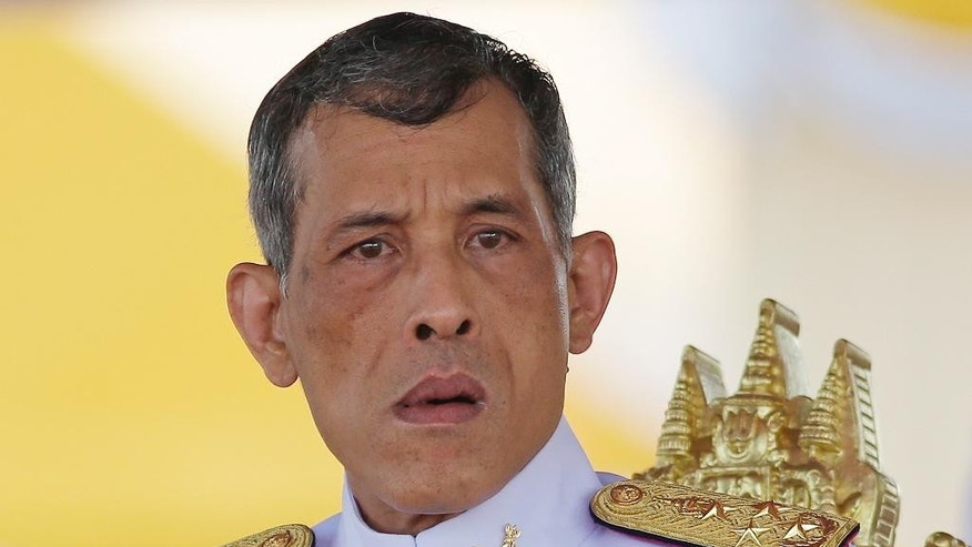 In this May 9, 2016, photo, Thailand's Crown Prince Vajiralongkorn is seated at the royal plowing ceremony in Bangkok. Thailand's parliament has started the process of naming Crown Prince Vajiralongkorn the new king following the death of his father, Bhumibol Adulyadej, last month. Completing a formality, the Cabinet submitted Vajiralongkorn's name to the National Assembly on Tuesday after a brief meeting. (AP Photo/Sakchai Lalit)