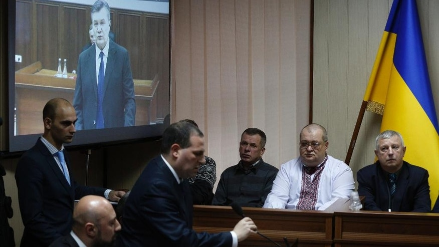 "Officials listen to former Ukrainian president Viktor Yanukovych at a court room in Kiev, Ukraine, Monday, Nov. 28, 2016. Yanukovych, who gave testimony to a Kiev court on Monday from a courtroom in Russia, said he did not give orders to his forces to open fire on protesters and ""could not have possibly given such orders."" (AP Photo/Sergei Chuzavkov)"