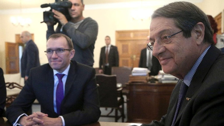 U.N. Special Advisor of the Secretary-General Espen Barth Eide, left, and Cyprus' President Nicos Anastasiades sit during their meeting at the presidential palace in divided capital Nicosia, Cyprus, Monday, Nov. 28, 2016. Eide meets with the Greek and Turkish Cypriot leaders after the talks with rivals' leaders at Mont Pelerin, Switzerland. (AP Photo/Petros Karadjias)