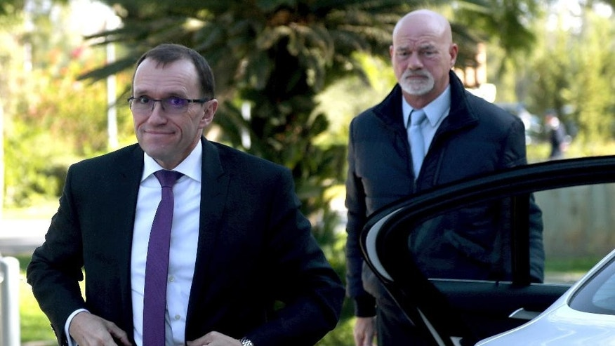 U.N. Special Advisor of the Secretary-General Espen Barth Eide, left, arrives at the presidential palace for talks with Cyprus' President Nicos Anastasiades in divided capital Nicosia, Cyprus, Monday, Nov. 28, 2016. Eide meets with the Greek and Turkish Cypriot leaders after the talks with rivals' leaders at Mont Pelerin, Switzerland. (AP Photo/Petros Karadjias)