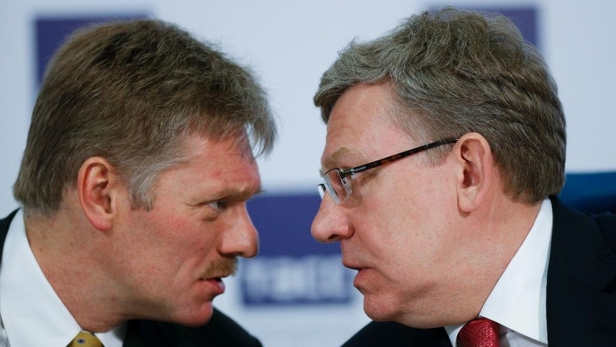 March 31, 2015: Russian President Vladimir Putin's press secretary Dmitry Peskov, left, speaks to Russia's former finance minister Alexei Kudrin at a round table to mark President Vladimir Putin's 15 years in office in Moscow.