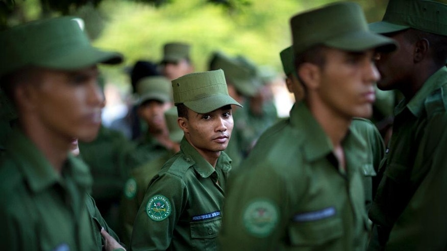 """Junior Cardozo, a 19-year-old soldier assigned to the Interior Ministry, waits in line with colleagues to pay tribute to the late Fidel Castro, near Revolution Plaza, in Havana, Cuba, Monday, Nov. 28, 2016. """"I feel deep pain over Fidel's death,"""" said Cardozo, """"He is a very good man. We will never forget him."""" (AP Photo/Rodrigo Abd)"""
