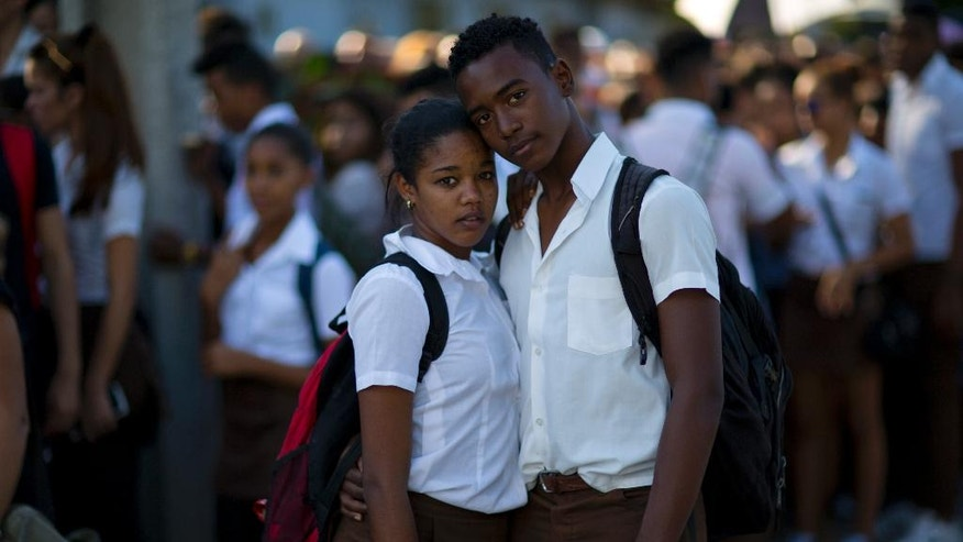 """National School of Art students Omar Alayo, 15, and Idemis Hernandez, 17, wait in line to pay tribute to the late Fidel Castro, near Revolution Plaza, in Havana, Cuba, Monday, Nov. 28, 2016. """"Because of Fidel's revolution I was able to study in a public school, that's impossible in many Latin American countries. We have to be very proud of this country.""""  (AP Photo/Rodrigo Abd)"""