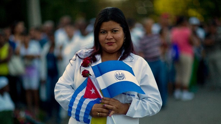 "Jhoanna Jimenez, 30, graduated from Cuba's Latin American School of Medical Sciences, poses for a photo as she waits in line to pay tribute to the late Fidel Castro, near Revolution Plaza, in Havana, Cuba, Monday, Nov. 28, 2016. ""I am sharing with the Cuban people all this pain. As a professional I owe this country a lot,"" Jimenez said, adding that in her native El Salvador, getting a university education is a near-impossible dream for poor people. ""Here it is possible. That's why I love Cuba and Fidel."" (AP Photo/Rodrigo Abd)"