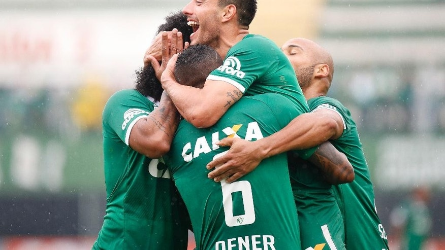 In this Oct. 10, 2016 photo, Chapecoense's Alan Ruschel celebrates with his teammates during a national soccer championship match in Chapeco, Brazil. Ruschel survived a plane crash carrying his Brazilian first division soccer club team to Medellin for a Copa Sudamericana final match. The chartered plane crashed into a Colombian hillside and broke into pieces, killing 75 people and leaving six survivors, Colombian officials said Tuesday. (Marcio Cunha/Mafalda Press via AP)