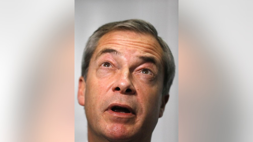 Former UK Independence Party (UKIP) leader Nigel Farage gestures during an interview with The Associated Press in London, Tuesday, Nov. 29, 2016. Farage addressed the media on how he met US President elect Donald Trump last week. (AP Photo/Frank Augstein)