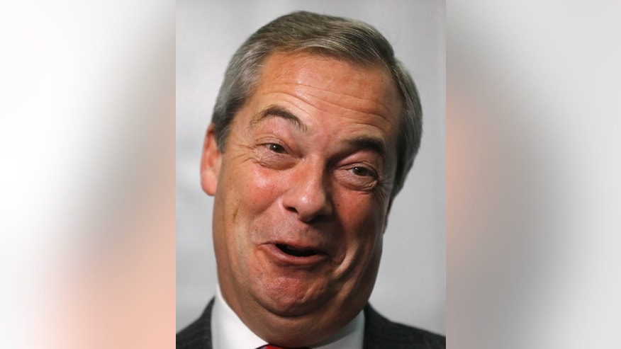 Former UK Independence Party (UKIP) leader Nigel Farage smiles during an interview with The Associated Press in London, Tuesday, Nov. 29, 2016. Farage addressed the media on how he met US President elect Donald Trump last week. (AP Photo/Frank Augstein)