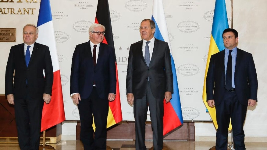 From left, French Foreign Minister Jean-Marc Ayrault, German Foreign Minister Frank-Walter Steinmeier, Russian Foreign Minister Sergey Lavrov and Ukrainian Foreign Minister Pavlo Klimkin pose before talks in Minsk Belarus, Tuesday, Nov. 29, 2016. Foreign Ministers of France, Russia, Ukraine and Germany attend Normandy Format talks in Minsk on the situation in the east of Ukraine. (AP Photo/Sergei Grits)